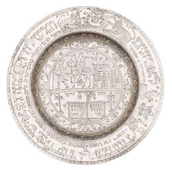 An image of a German silvered-pewter Purim plate that dates to 1771 and is engraved with scenes from the Book of Esther