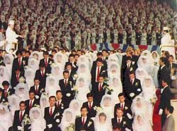 A picture of holy water being sprinkled on 6,000 couples as part of a 1982 mass wedding in Korea