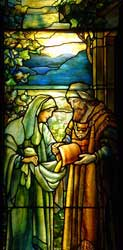 An image of Boaz giving grain to his future wife Ruth as depicted in a Tiffany window at Temple Emanuel in Grand Rapids, Michigan